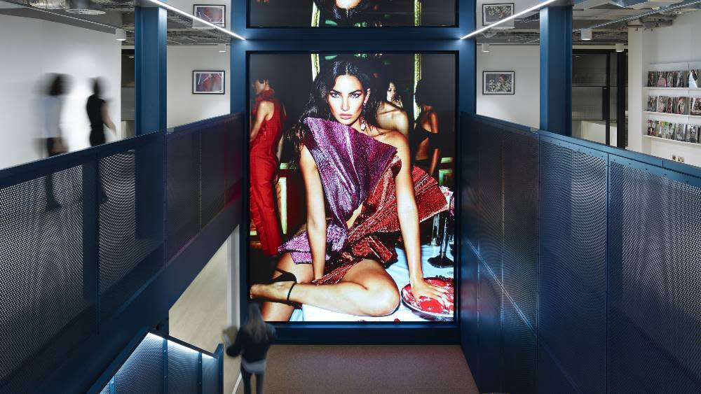 A screen displaying a fashion model, representing Further's online qual research work with Conde Nast.