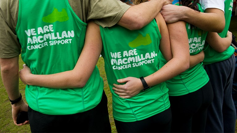A group of runners in green Macmillan shirts, representing Further's online qual research work with Macmillan Cancer Support.